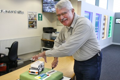 Brownhills and Caravan Guard customer Mt Strutt cuts 15 year celebration cake