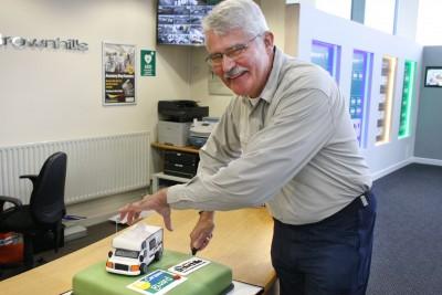 Brownhills and Caravan Guard customer Mt Strutt cuts 15 year celebration cake