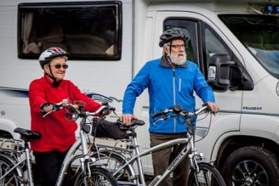 Cycling couple with motorhome