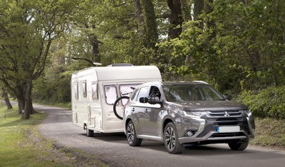 Hyrbid electric car towing caravan