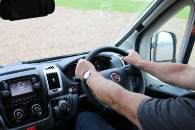 Motorhome reversing two hands on the wheel
