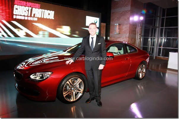 Dr Andreas Schaaf, President, BMW India with the new BMW 6 Series Coupe 121011