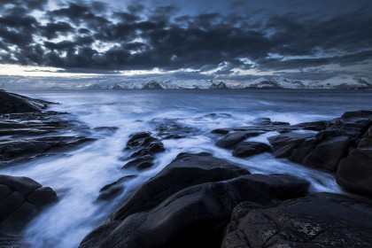 Surf on rocky coast, Norway
