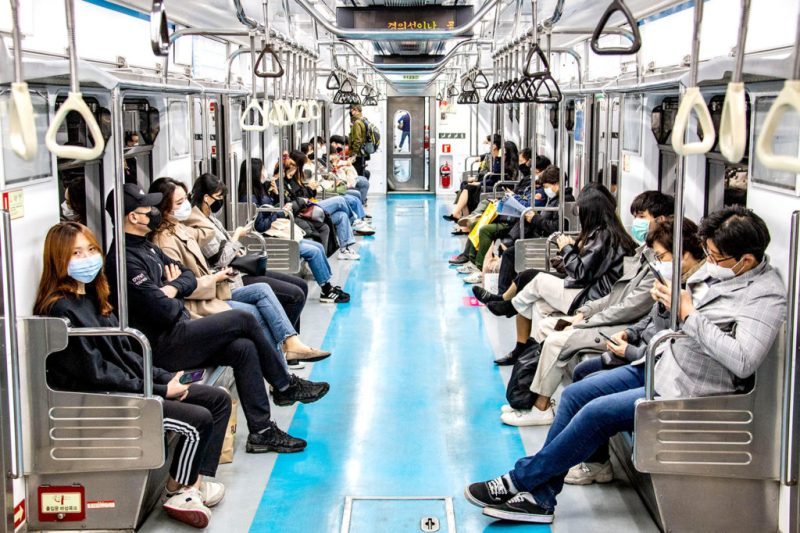 Commuters wear protective masks during the coronavirus pandemic, Seoul, South Korea, 28 March 2020. Credit: dbimages / Alamy Stock Photo. 2BAPB88