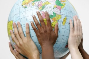8824378 - people holding up a globe