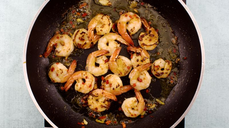 Low-Carb, Gluten-Free Garlic Prawns Recipe - Stir or shake over a high heat for about 3-4 minutes