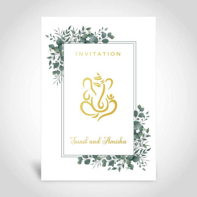 An Indian wedding card with gold foiling and a leaf border