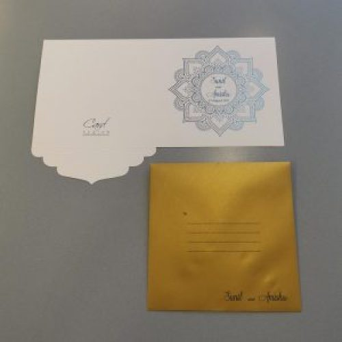 Square invitation card with a mandala design - outside view, with a matching metallic gold envelope.