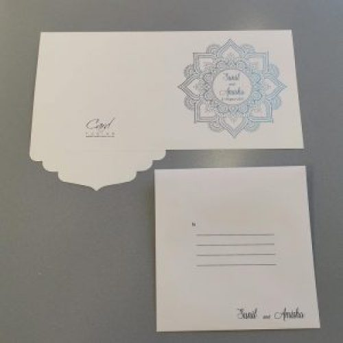 Square invitation card with a mandala design - outside view, with a matching white envelope.