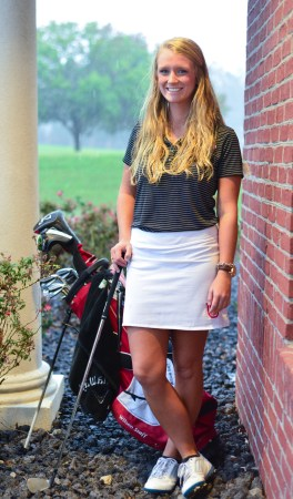 Ann Elizabeth Lynch, senior business management major, is a member of the university's golf team.