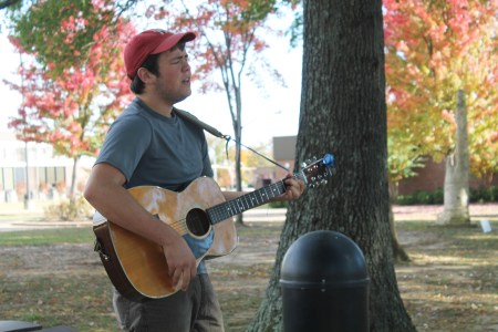 Cameron Skonhovd, sophomore music major, plays worship music at the Prayer Labyrinth.