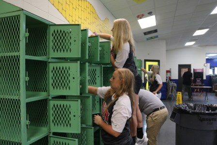 Union Softball cleaning out lockers at the Boys and Girls Club