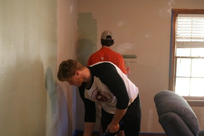 Union's Baseball team painting a house