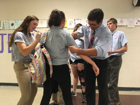 DCC Seniors Bid Each Other Farewell by Signing School Shirts