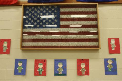 Elementary Students Art Work Hung Up in Preparation for Veterans Celebration