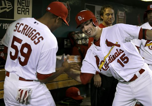 St. Louis Cardinals' Randal Grichuk, right, is congratulated by teammate Xavier Scruggs after hitting a solo home run during the first inning of a baseball game against the Cincinnati Reds Friday, Sept. 19, 2014, in St. Louis. (AP Photo/Jeff Roberson)