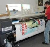 Man looking at printing machine