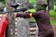 boy playing paintball