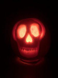 Pumpkin carved as skull