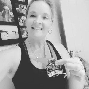 Theresa from Treat Time with a race medal from our 10K last year