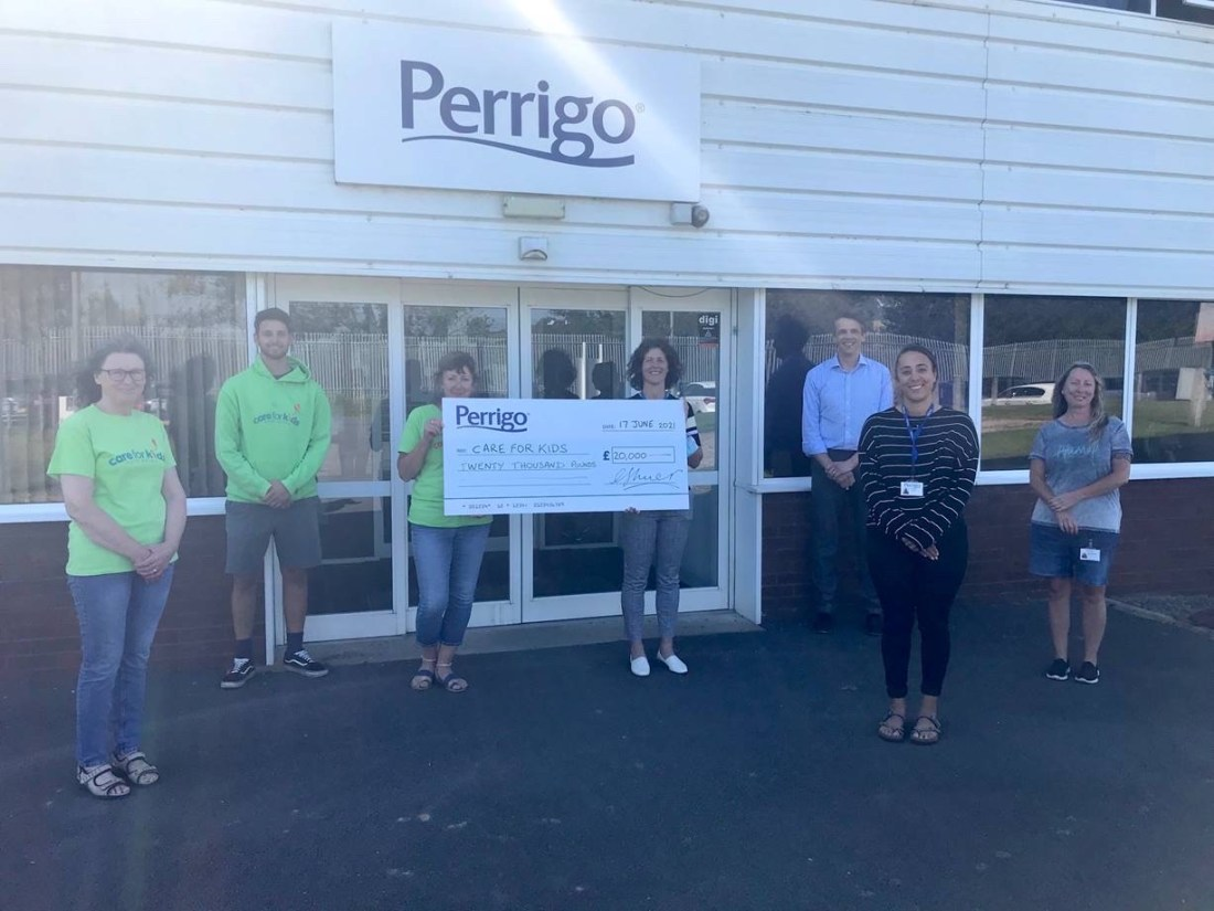 Care for Kids trustees and staff from Perrigo outside the Perrigo site with a giant cheque for £20,000