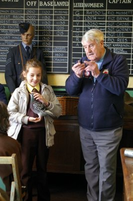 St Teilo's RC School Years Five and Six Pupils attentively listening to  John Brock story of heroic pigeons