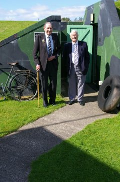 President of Tenby Branch of the Royal British Legion, Gordon Prime, and John Brock MBE reminisce outside the Museum's Stanton Air-raid shelter.