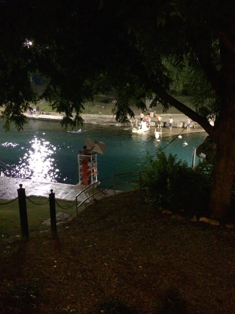 barton springs a of a pool with burgers and treats