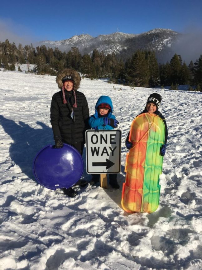 There's one way down the hill; the carful of kids can't get enough of the deep snow in Lake Tahoe. Free sledding,