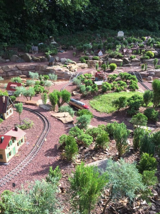 Epcot's Garden Railway enchants kids and adults alike in Germany with it's tiny town and bonsai-like landscape. International Flower and Garden Festival