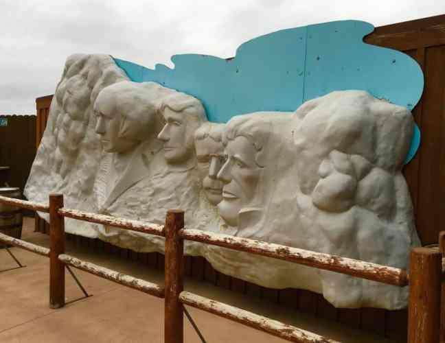 Wall Drug in South Dakota features a replica of Mount Rushmore.