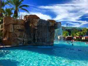 A water slide and waterfall at the pool keeps kids busy.