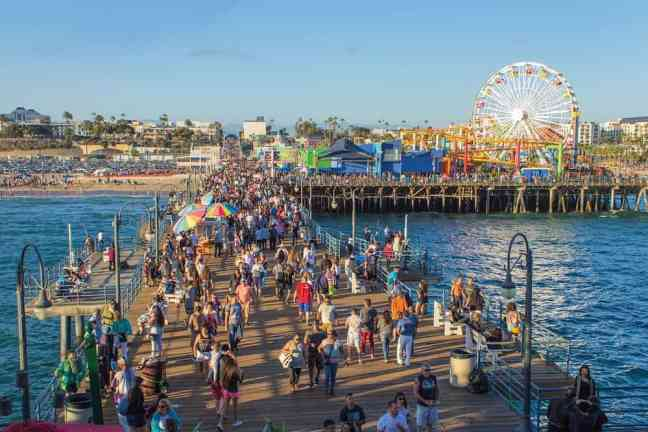 Walk along Santa Monica Pier, where to go in LA with kids.