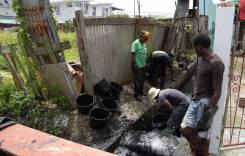 State Minister answers Alexander Village residents' cries for relief from flooding