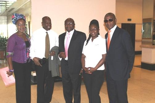 Denis St Bernard, Wale Sonaike, Carol Vaughan-Roberts and Bola Akindele in the lobby of Jamaica Pegasus