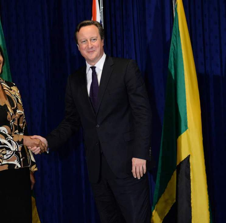 "Cameron visit to Caribbean - Day One. Prime Minister David Cameron is greeted by Jamaican Prime Minister Portia Simpson-Miller at her office, Jamaica House, in Kingston, on the first of a two day visit to the Caribbean. Picture date: Tuesday September 29, 2015. The Prime Minister flew into Jamaica promising a £200 million infrastructure aid boost to ""reinvigorate"" ties with the region - with UK firms set to compete to build roads, ports and bridges. See PA story POLITICS Cameron. Photo credit should read: Stefan Rousseau/PA Wire URN:24284816"
