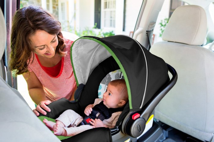 buckling the baby into the car seat