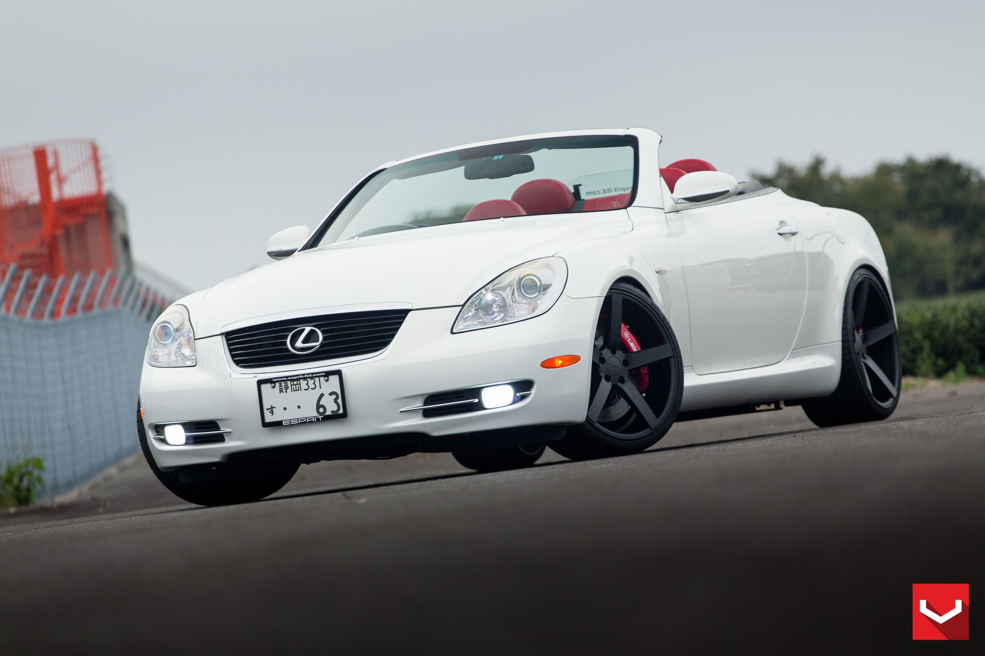 Sleek White Lexus SC on Matte Black Vossen Rims Fitted with Red