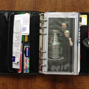 Wallet and Stanley Cup photo - the first things I see when I open my planner