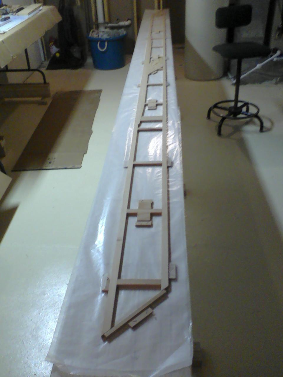 The half spar on the table. Note there is wax paper between the parchment paper and the pieces to be glued