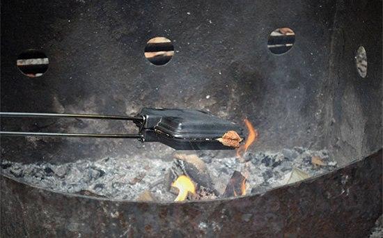 pie iron over an open fire