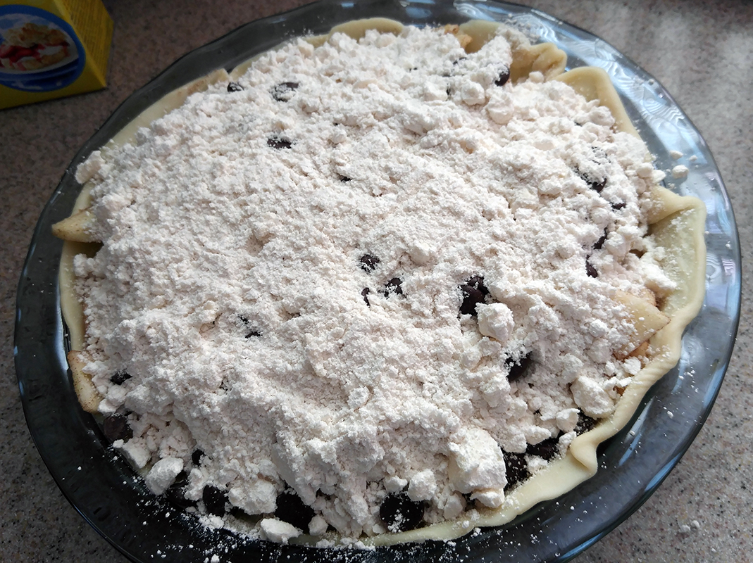 Top pie with crumble mixture.