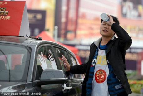 Chinese man wins BMW 1-series by Touching it for 87 hours