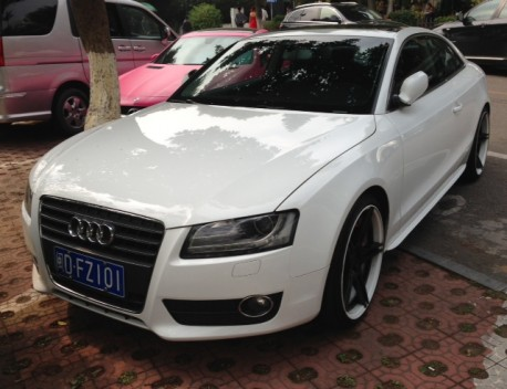 Audi S5 Coupe with giant black alloys in China
