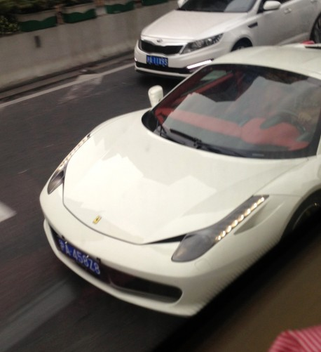 White Ferrari 458 Spider has a License & a red interior in China