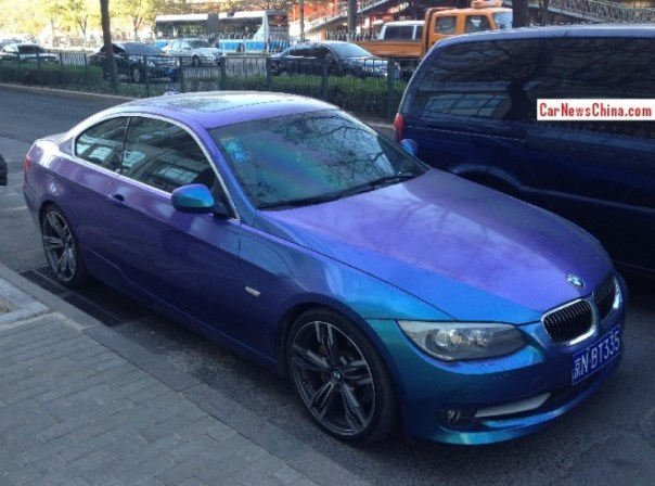Shiny blue purple BMW 335i Coupe has a License in China