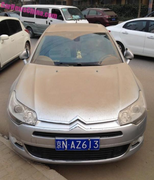 Don't park your Car near a Construction Site in Beijing...