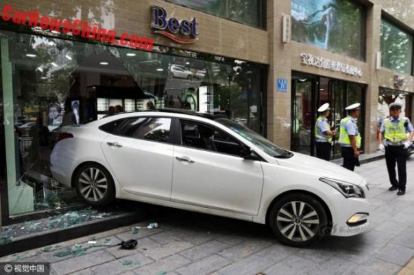 Chinese Woman Crashes Hyundai Into An Eyeglass Store
