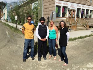 Team Alpine Start, Laura & Lisa with Ryan and a local actor in the streets of Dawson.