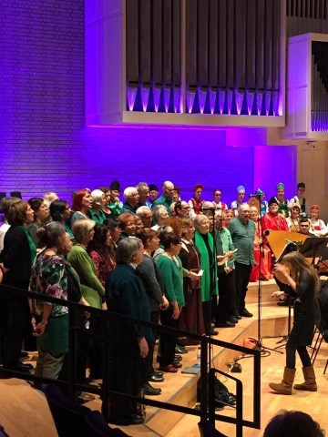 Open Voice choir wearing green